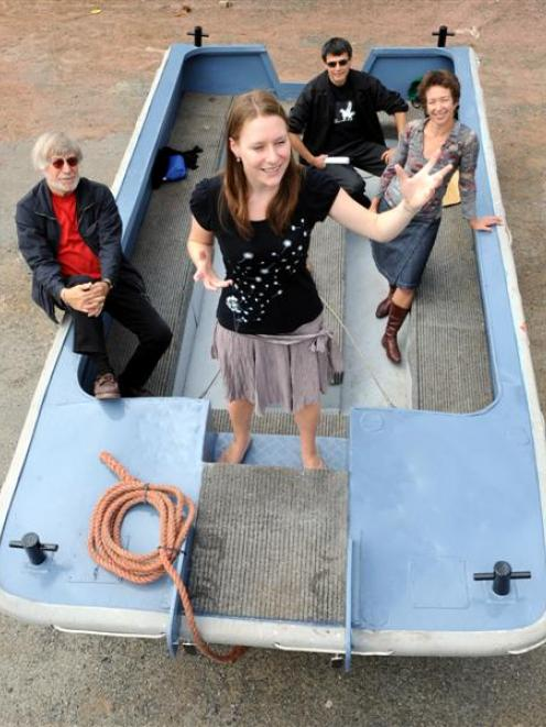 Trying out their floating platform at Ferrum Engineering Ltd yesterday are poets (from left)...