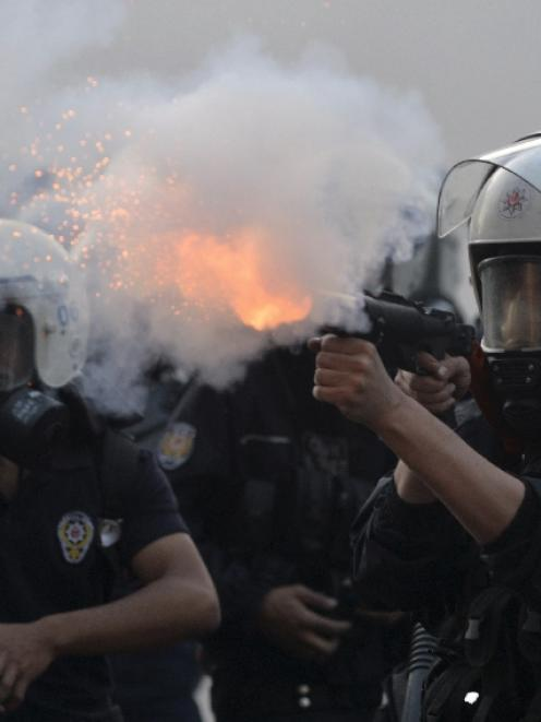 Turkish police fired teargas and water cannon to disperse protesters in central Istanbul. Photo...