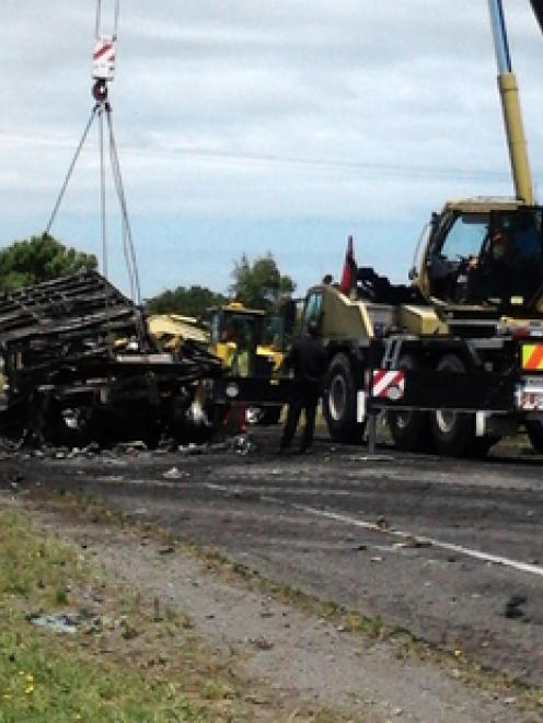 Two large trucks - a B-train and a semi-trailer - and a Nissan vehicle were involved in the crash...