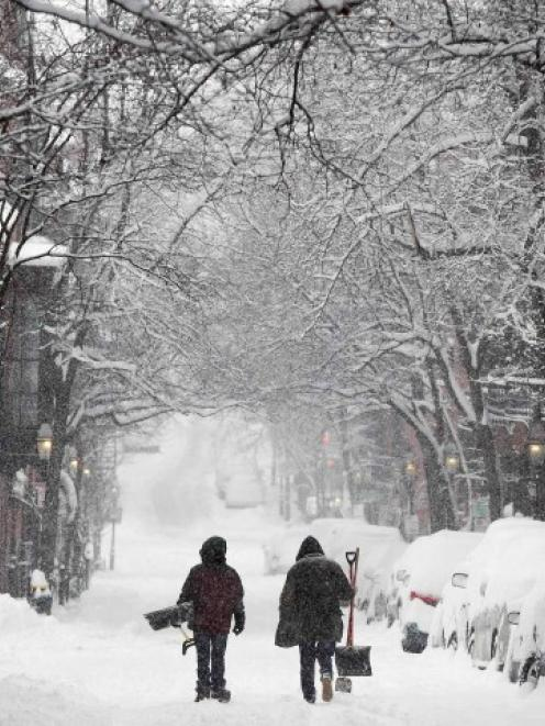 Two men walk down Pinckney Street on Beacon Hill in Boston, Massachusetts. REUTERS/Dominick Reuter
