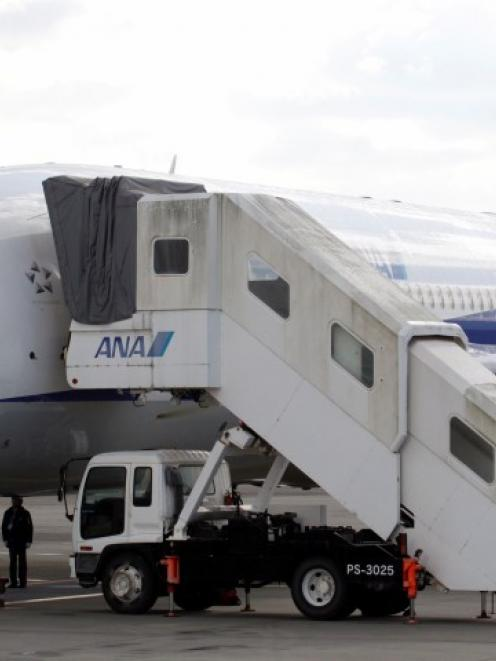 U.S. Federal Aviation Administration technical advisor Eric West (L) inspects All Nippon Airways'...