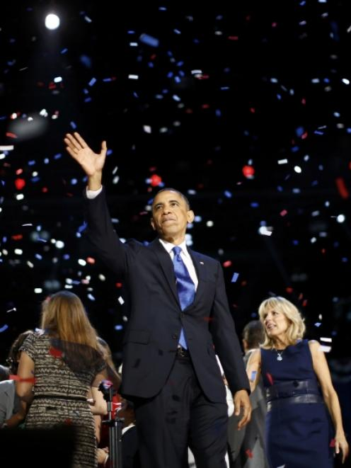 US President Barack Obama celebrates after his victory speech on election night in Chicago. Photo...