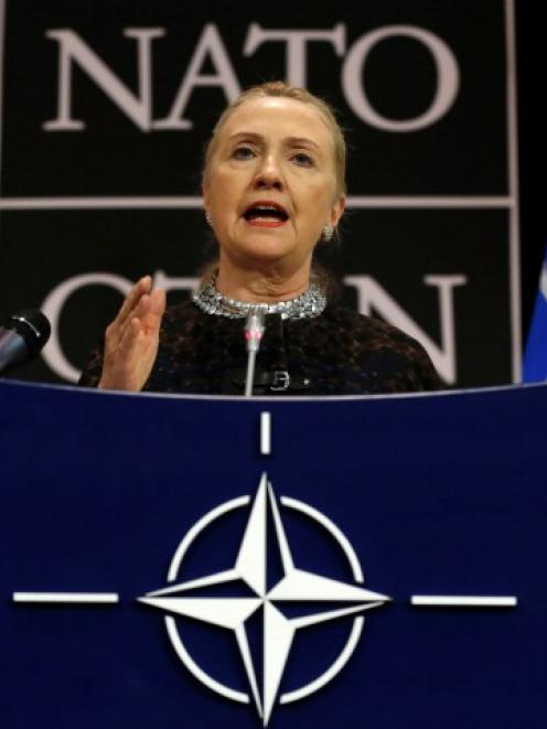 U.S. Secretary of State Hillary Clinton speaks during a news conference at the NATO headquarters...