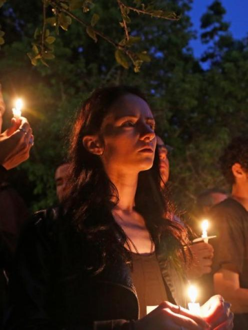 UC Santa Barbara students attend a candlelight march and vigil following the killings. REUTERS...