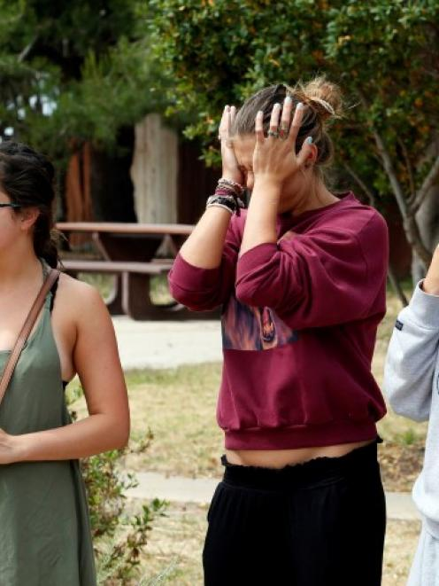 UC Santa Barbara students react near the scene of the shooting in the Isla Vista section of Santa...