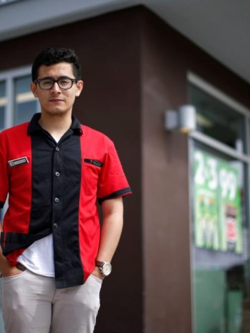 UCSB student and 7-Eleven employee Jorge Anaya stands outside the Isla Vista store where he saved...