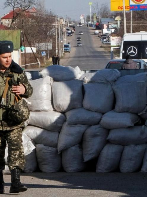 Ukrainian border guards stand at a checkpoint at the border with Moldova breakaway Transnistria...