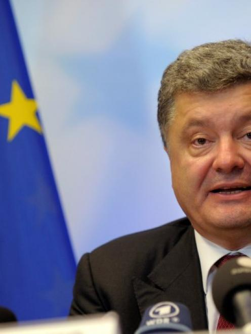 Ukrainian President Petro Poroshenko holds a news conference at the European Council headquarters...