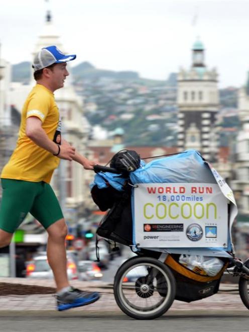 Ultra-marathon runner Kevin Carr runs through Dunedin on the New Zealand leg of his attempt to...