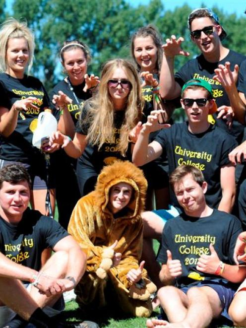 Unicol residents surround Luke Easton (21), who is dressed up as the college's mascot, Leo the...