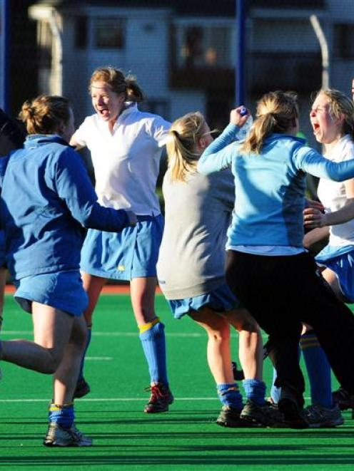 University A players show their delight at beating Taieri A 3-0 in the Dunedin premier women's...