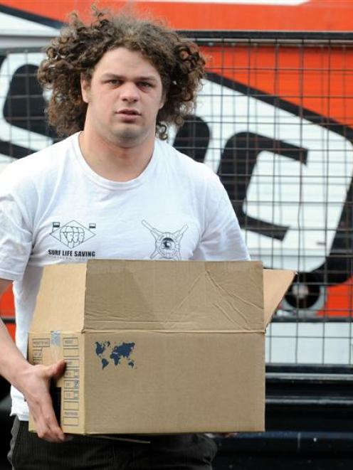 University of Canterbury Engineering Society president Carl Shrimpton unloads the cans of food it...