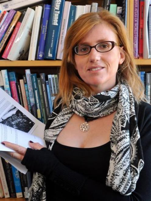 University of Otago academic Dr Erika Pearson is pictured with a downloaded version of a new...