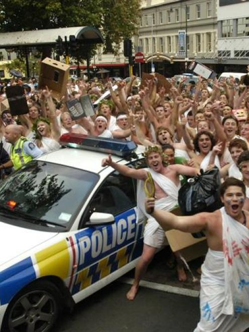 University of Otago first-year students gather in the Octagon in Dunedin last night during the...