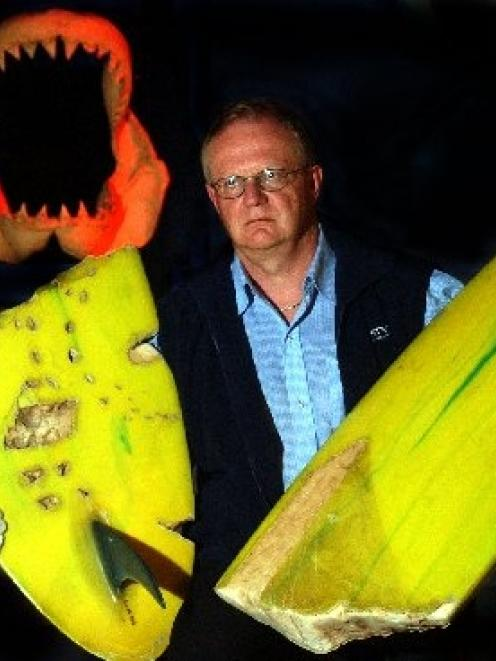 University of Otago forensic dentist Prof Jules Kieser with Barry Watkins' surfboard and a set of...