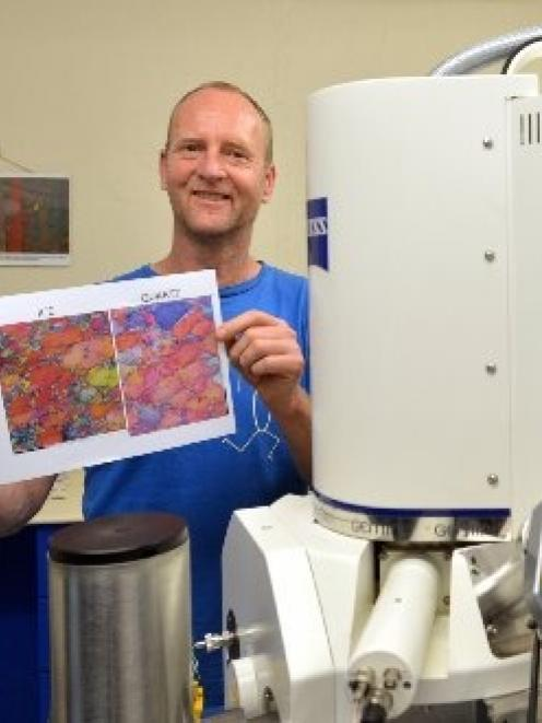 University of Otago geologist Prof David Prior, pictured beside an electron microscope, displays...