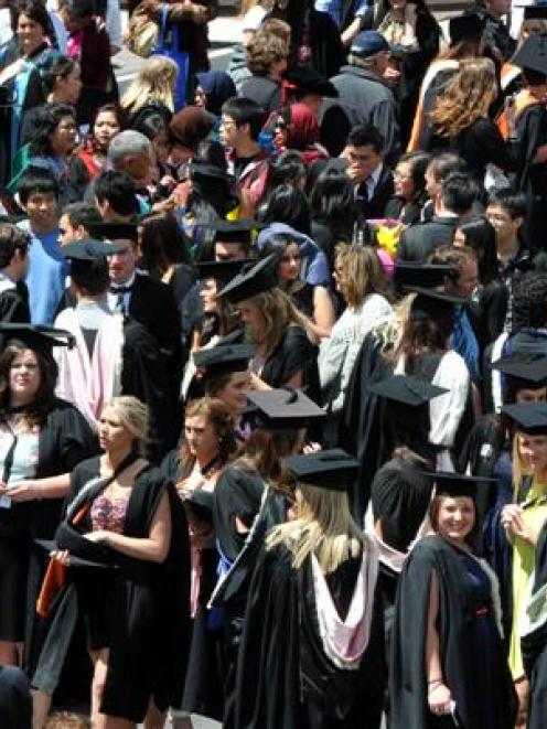 University of Otago graduands move towards a capping ceremony at the Dunedin Town Hall on...