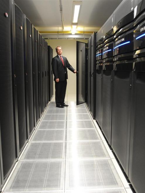 University of Otago information technology services director Mike Harte inspects one of the...