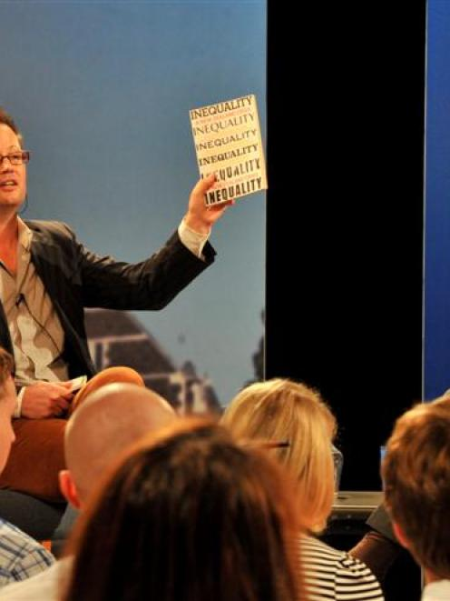 University of Otago politics lecturer Dr Bryce Edwards holds a copy of Inequality: A New Zealand...
