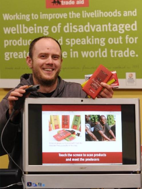 University of Otago postgraduate applied science researcher Jason Taylor shows the Trade Aid...