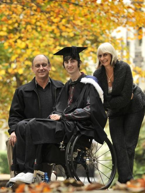 University of Otago psychology graduand Tim Young, flanked by parents Phil and Viv Young,...