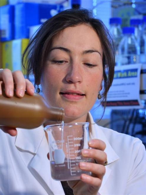 University of Otago researcher Dr Sara Hanning pours  a liquid intended to counter ''dry mouth''....