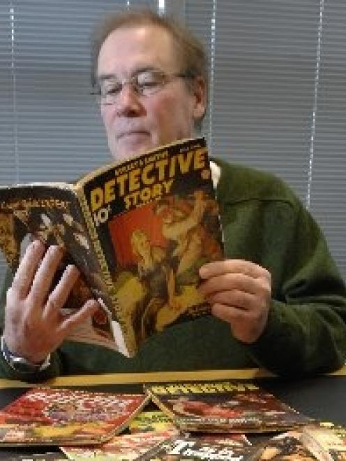 University of Otago special collections librarian Donald Kerr with some of the pulp fiction...