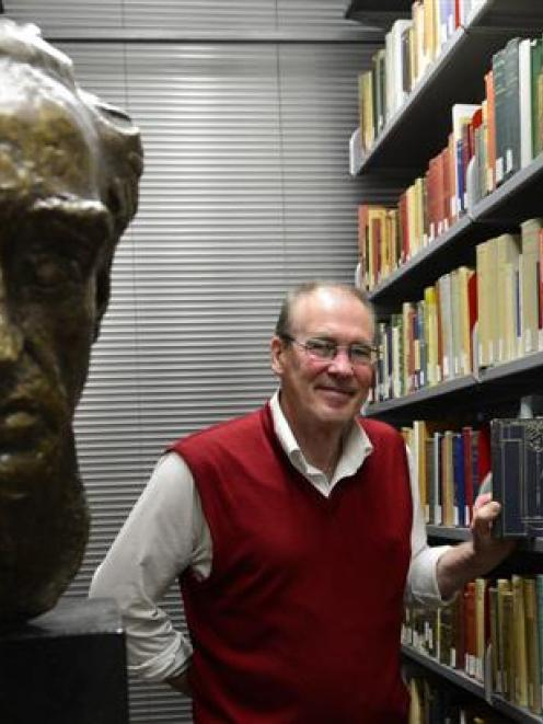 University of Otago Special Collections librarian Donald Kerr browses through the Charles Brasch...