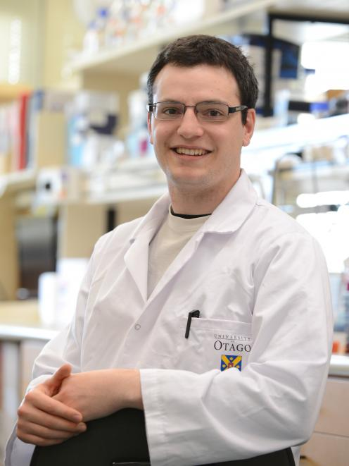 University of Otago  student Chris Harris (25) continues work at the cancer genetics laboratory,...