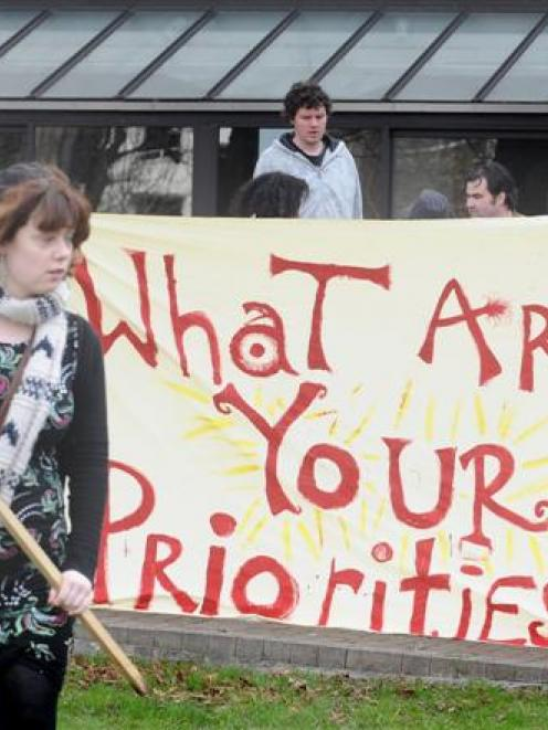 University of Otago student Hayley Gyto (19) protests against cuts to the education budget during...