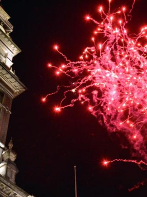 Up to 20,000 people came to see the midnight fireworks display in Dunedin's Octagon. Photo by...