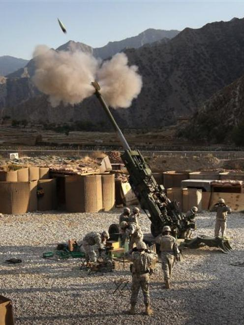 US artillerymen fire a 155mm howitzer at a Taleban position from Camp Blessing in the Kunar...