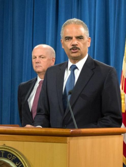 US Attorney General Eric Holder announces the indictments of five Chinese nationals on cyber...