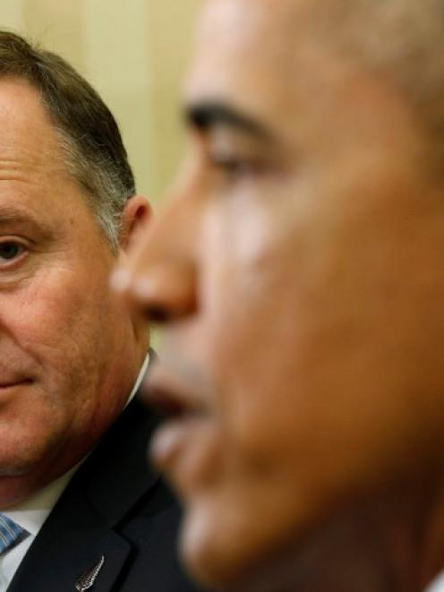 US President Barack Obama and New Zealand Prime Minister John Key in discussion in the White...