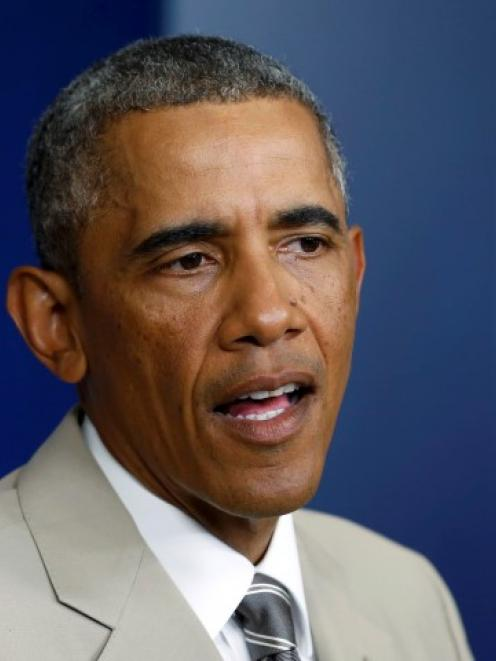 US President Barack Obama answers questions in the White House Press Briefing Room ahead of a...