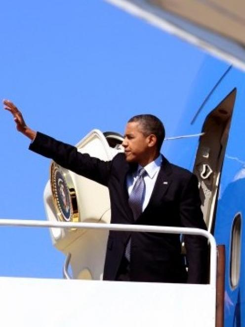 US President Barack Obama boards Air Force One at Joint Base Andrews as he departs Washington....