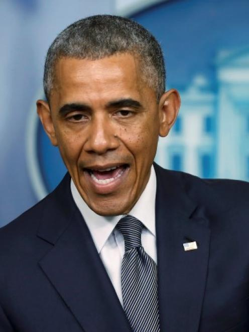 US President Barack Obama discusses the situation in Ukraine during a news conference at the...
