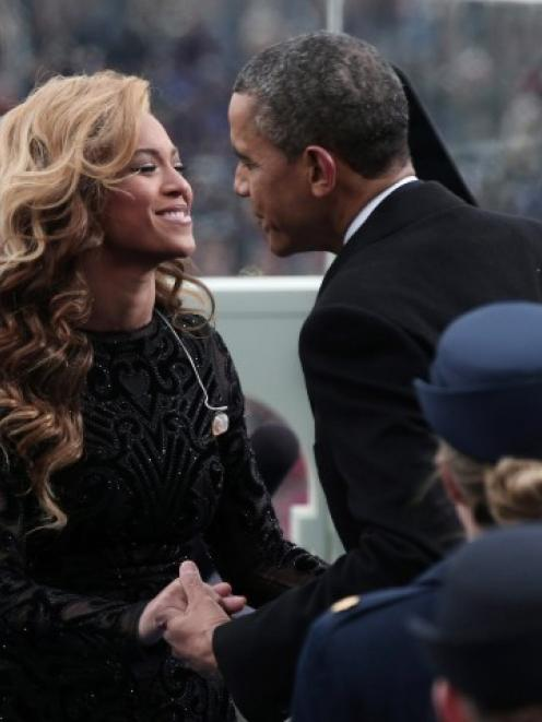 US President Barack Obama greets singer Beyonce after she performed the National Anthem during...