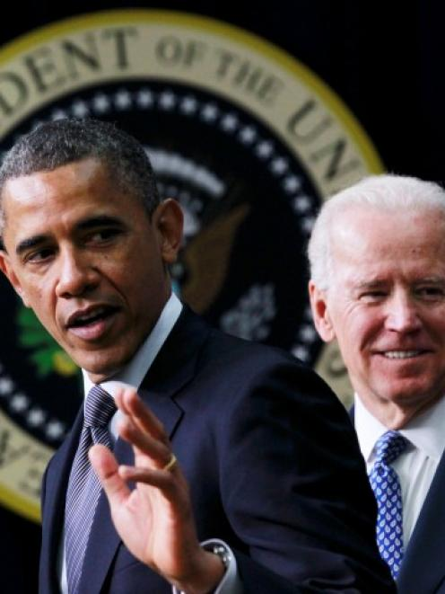 US President Barack Obama (L) unveils a series of proposals to counter gun violence as Vice...