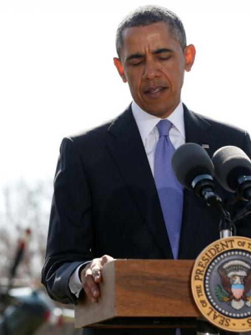 US President Barack Obama pauses while making a statement about Ukraine on the South Lawn of the...