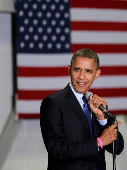 US President Barack Obama speaks during a campaign rally at Cornell College in Mt Vernon, Iowa....