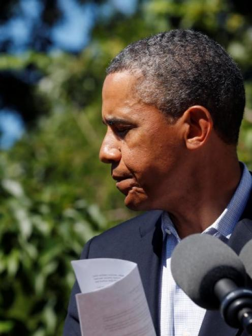 US President Barack Obama steps back after speaking about the violence in Egypt while at his...