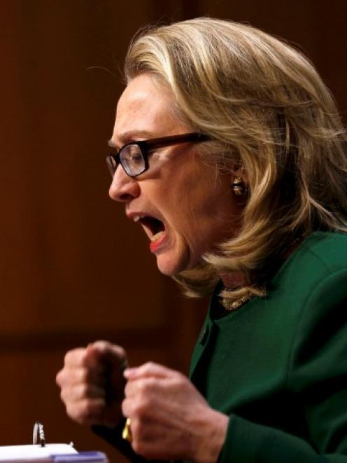 US Secretary of State Hillary Clinton pounds her fists as she responds to questioning on the...
