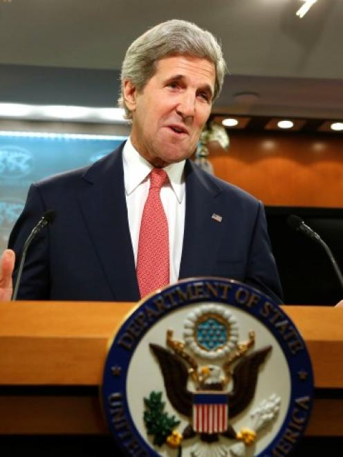 US Secretary of State John Kerry delivers a statement on Ukraine from the State Department press...