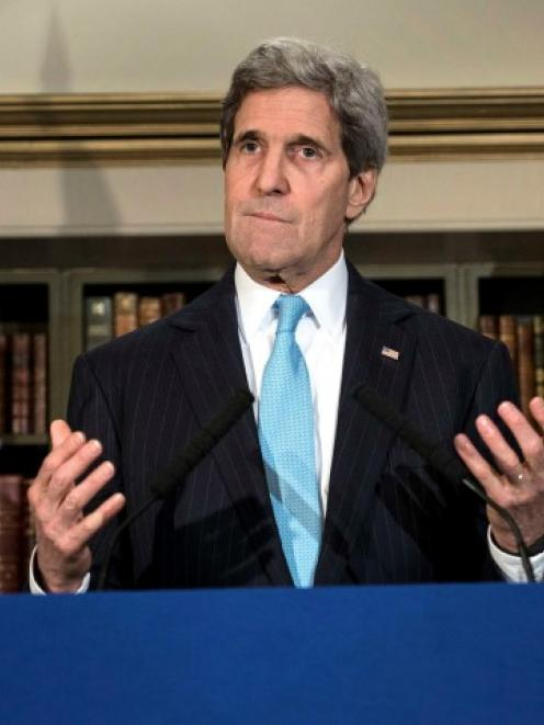 US Secretary of State John Kerry pauses while speaking during a news conference in London where...