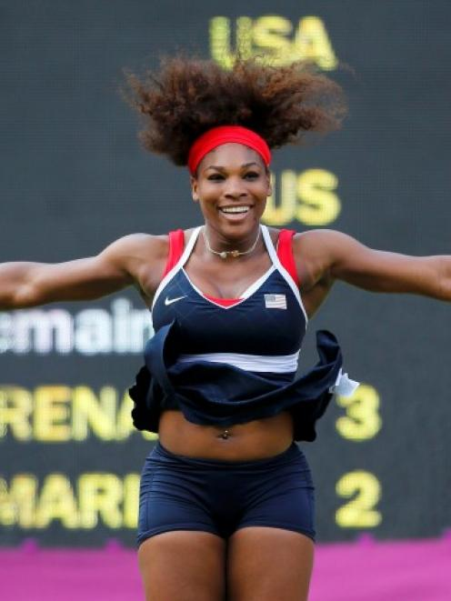 US tennis player Serena Williams celebrates after winning the women's singles gold medal match...