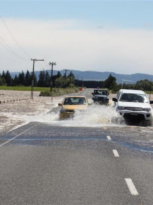 Vehicles  negotiate flooding on the Rakahouka-Hedgehope Rd, about 5km south of Hedgehope, where...