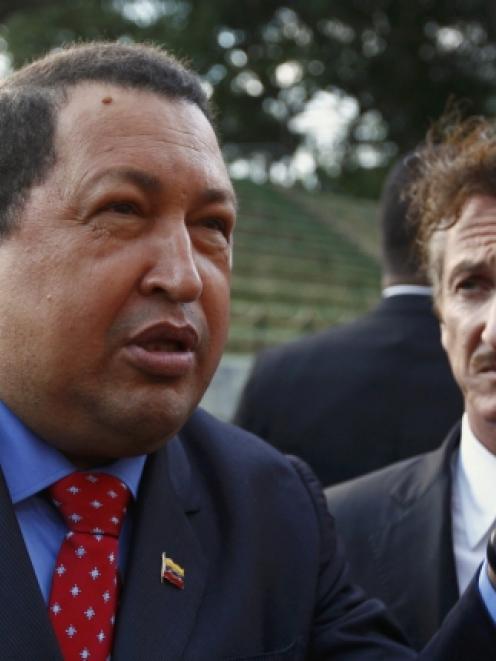 Venezuelan President Hugo Chavez welcomes US actor Sean Penn at Miraflores Palace in Caracas...