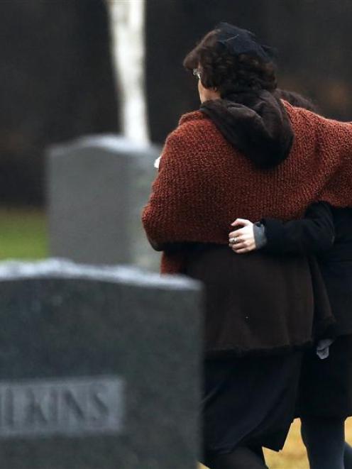Veronique Pozner (left), mother of Sandy Hook Elementary school shooting victim Noah Pozner,...