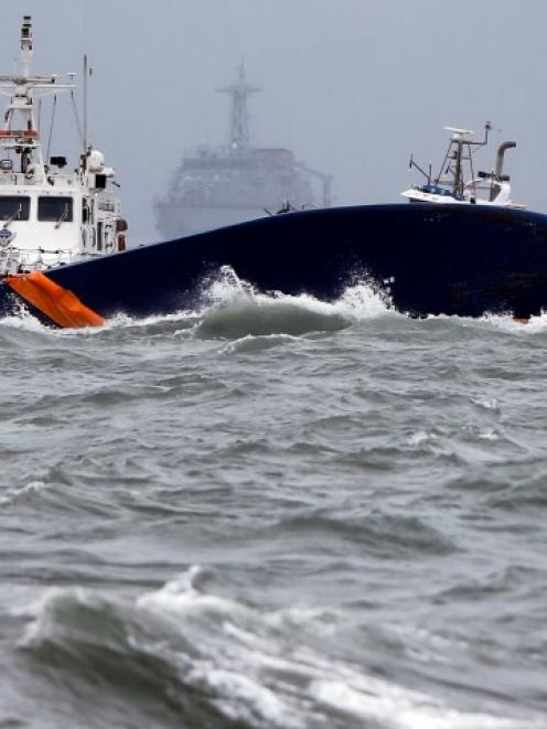 Vessels involved in salvage operations are seen near the upturned Sewol ferry. REUTERS/Issei Kato